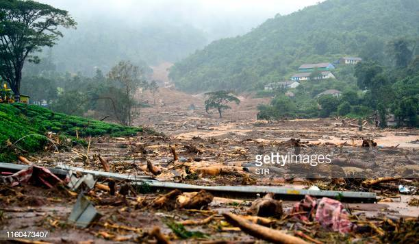 TOPSHOT A damaged area is pictured following a landslide in Meppadi Wayanad district in the Indian state of Kerala on August 9 2019 Floods that have...