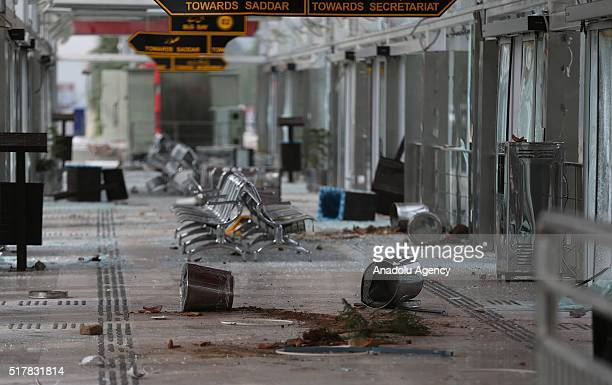 """Damaged area, near parliament house where thousands of protesters who managed to reach the area, commonly known as """"red zone"""", is seen as supporters..."""