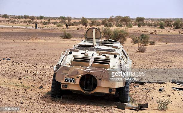 Damaged armoured vehicle abandonned by the Malian army near Ansongo, a northern Mali region under the control of the Movement for Oneness and Jihad...