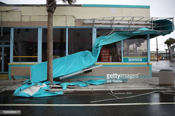 A damaged awning is seen as winds from Hurricane Florence on September 14 2018 in Myrtle Beach United States Hurricane Florence is hitting along the...