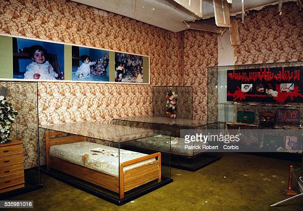A damaged bedroom on display in Colonel Qadaffi's villa after the American bombings of 1986 with pictures of children killed in the event In 1986 the...