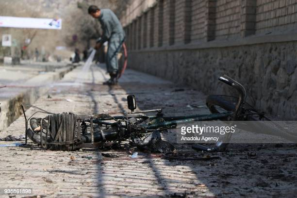 A damaged bicycle is seen on the ground after a suicide bomb blast that targeted a shrine visited by Shi'ite Muslims as the country observes the...