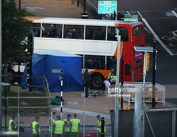 A damaged bicycle lays next to an Olympic Games bus on Day 5 of the London 2012 Olympic Games outside of Olympic Park on August 1 2012 in London...