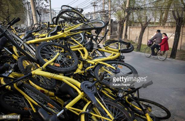 Damaged bicycles from the bike share company Ofo Inc are seen after they were collected from the streets at a repair depot for the company on March...
