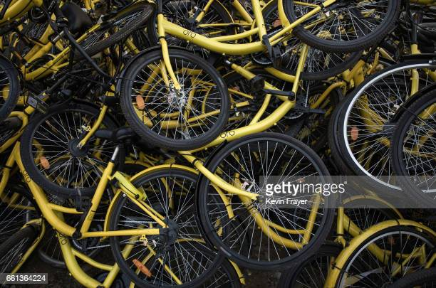 Damaged bicycles from the bike share company Ofo Inc that were pulled off the streets are seen piled up where they are kept at a repair depot for the...