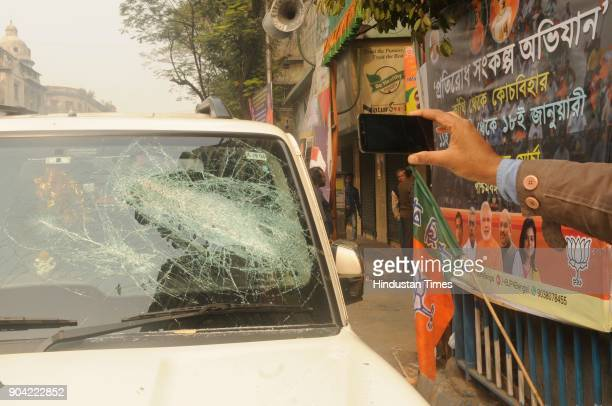 A damaged BJP supporter's car in front of BJP party office after tension between BJP and Trinamool supporters at North Kolkata area on January 12...