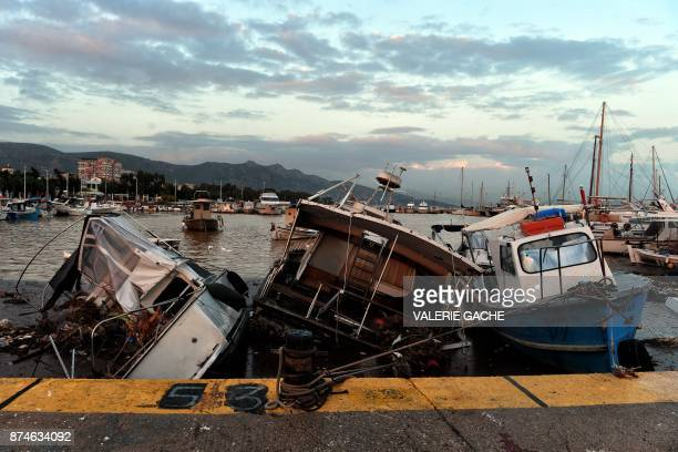 Damaged boats are moored at a harbour in Nea Peramos southwest of Athens on November 15 after heavy overnight rainfall in the area caused damage and...
