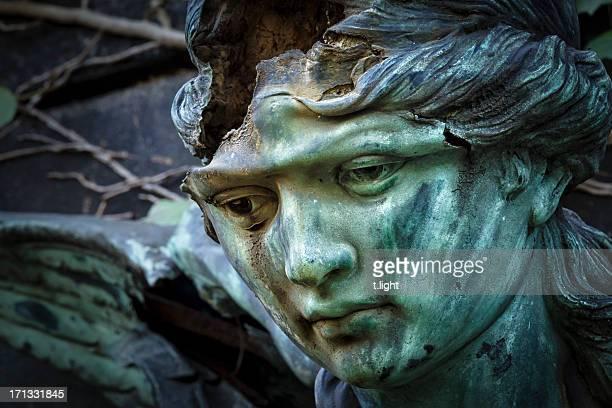 Damaged bronze head