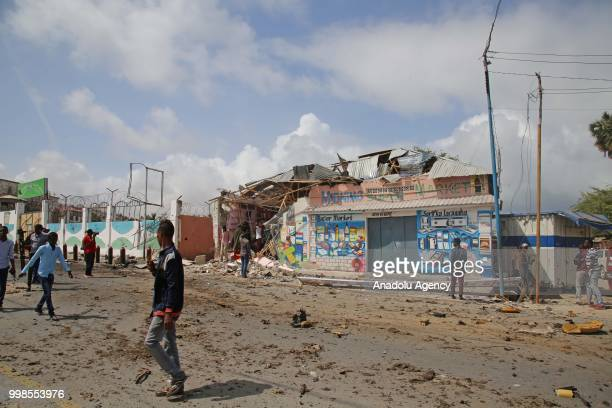 A damaged building is seen after a double car bomb blast at a security checkpoint near the presidential palace followed by a gun battle in Mogadishu...