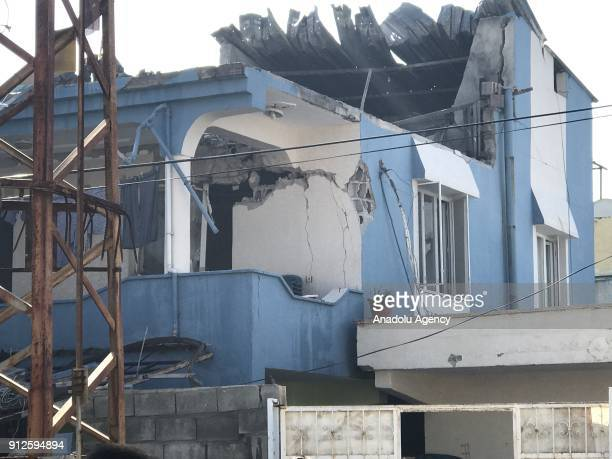 A damaged building is seen after a rocket attack by Syrianbased PYD/PKK terrorists on January 31 2018 in Reyhanli district of Hatay Turkey Turkey...