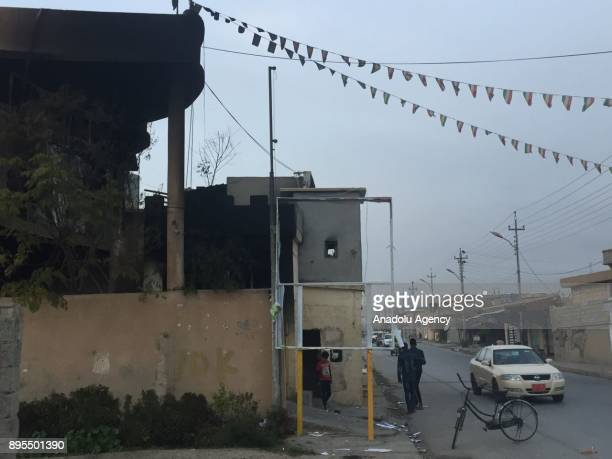 A damaged building is seen after demonstrators took part in the antigovernment protests in Taktak district of Sulaymaniyah Iraq on December 19 2017