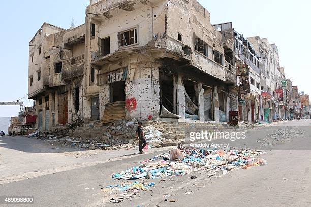 A damaged building is seen after the clashes between the Houthi Ansarullah movement members and the people's opposition forces supporting President...