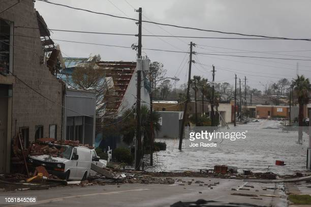Damaged buildings and a flooded street are seen after hurricane Michael passed through the downtown area on October 10 2018 in Panama City Florida...