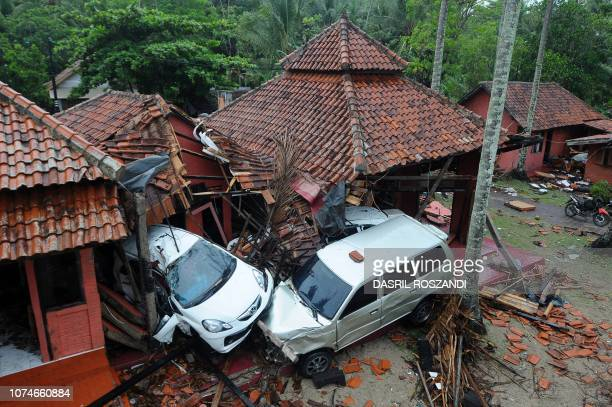 Damaged buildings and cars are seen in Anyer, Serang on December 23 after the area was hit by a tsunami on December 22 following an eruption of the...