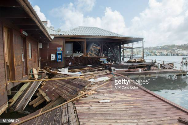 Damaged buildings and workshops are seen standing empty in Oyster Pond on the French Caribbean island of SaintMartin three weeks after the passing of...