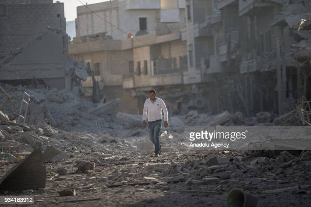Damaged buildings are seen after a bomb planted by YPG/PKK terrorists exploded in a fourstory building in Afrin town center in Syria on March 19 2018...