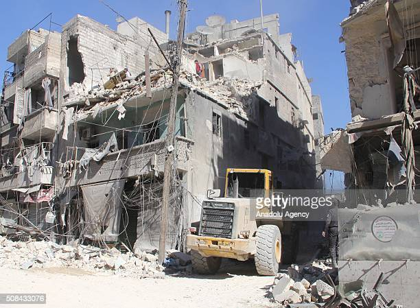 Damaged buildings are seen after the war crafts belonging to the Russian army carried out airstrikes on opposition controlled Qallasa neighbourhood...