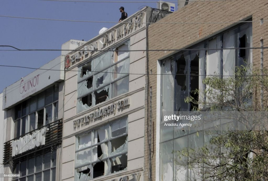 Damaged buildings are seen at the explosion site at the upmarket area in Lahore February 23 2017 At least eight people were killed and dozens injured.