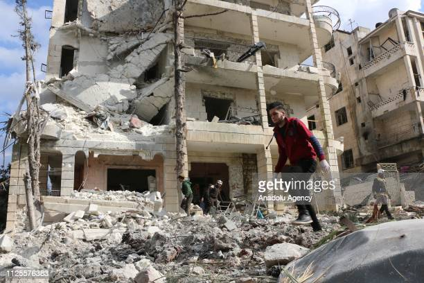 Damaged buildings are seen at the site after the consecutive bomb attacks with two bombladen vehicles in Idlib city centre Syria on February 18 2019...