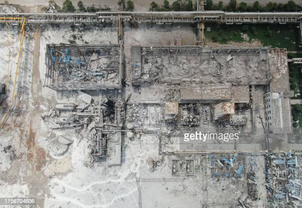 TOPSHOT Damaged buildings are seen at the site of an explosion at the Henan Coal Gas Group factory in Yima city in China's central Henan province on...