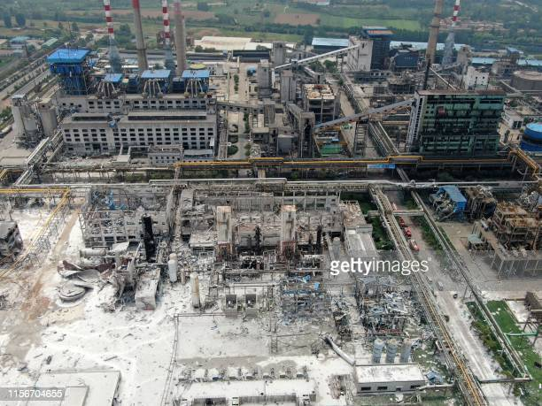 Damaged buildings are seen at the site of an explosion at the Henan Coal Gas Group factory in Yima city in China's central Henan province on July 20...