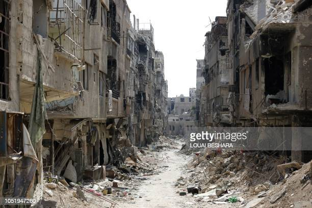 Damaged buildings are seen in Rama Street in the Yarmuk Palestinian refugee camp on the southern outskirts of the Syrian capital of Damascus on...