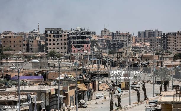 Damaged buildings are seen in western Raqa on July 12 during an offensive by Syrian Democratic Forces an alliance of Kurdish and Arab fighters to...