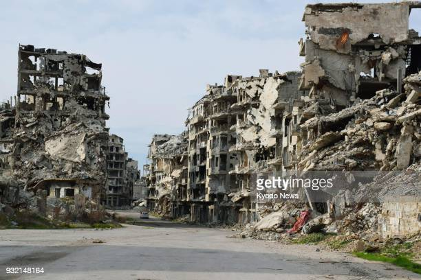 Damaged buildings line a street in the warravaged city of Homs in central Syria on Feb 14 2018 ==Kyodo