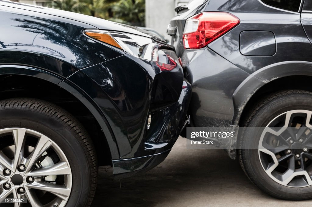 Damaged bumpers from car accident : Stock Photo