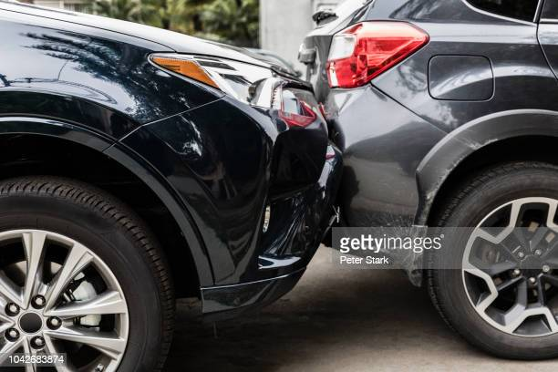 damaged bumpers from car accident - crash stock pictures, royalty-free photos & images
