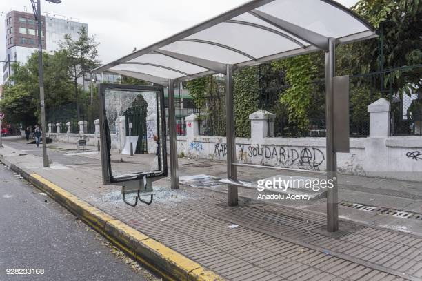 Damaged bus stop is seen after clashes broke out between students and riot police during a protest due to dissatisfaction of educational centers and...