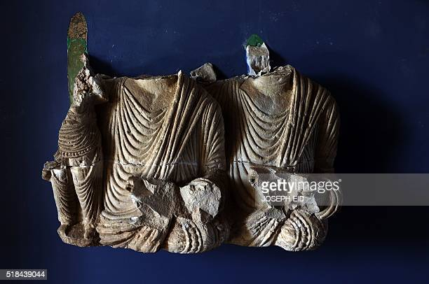 Damaged busts are seen in Palmyra's museum in the ancient Syrian city on March 31 2016 Syrian troops backed by Russian forces recaptured Palmyra on...