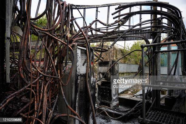 Damaged cabling and telecommunications equipment is pictured following a fire at a phone mast attatched to the chimney at the converted Fearnleys...