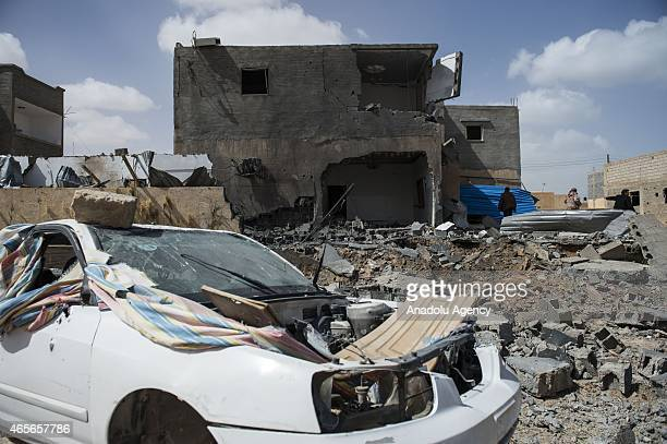 A damaged car and damaged buildings are seen in Bin Jawad city of Libya as the clashes between Tripoli government's Suruk forces and Tobruk...