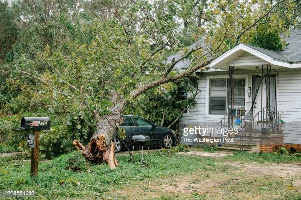 A damaged car and home in West Pensacola The area received a lot of damage after Hurricane Sally came through as a category 2 hurricane in Pensacola...