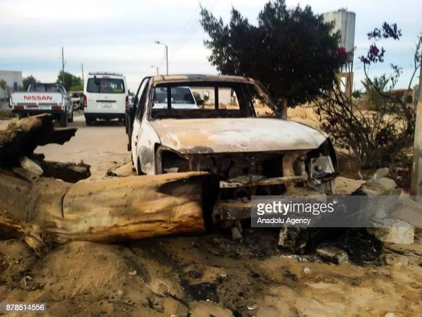 A damaged car at the site of the Egypt Sinai mosque bombing in AlArish Egypt on November 24 2017 The death toll from a bomb that went off outside a...
