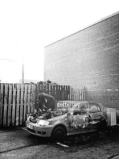 damaged car in auto repair shop - car crash wall stock photos and pictures