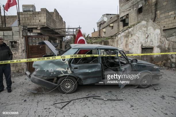Damaged car is seen after a rockets fired from across the border landed in Turkeys Reyhanli district in southern Hatay province of Turkey on January...