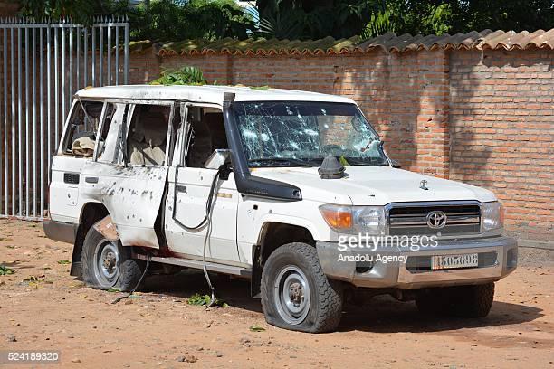 A damaged car is seen after heavily gun men attacked to General Athanase Kararuza a security advisor to one of Burundi's vice presidents vehicle at...