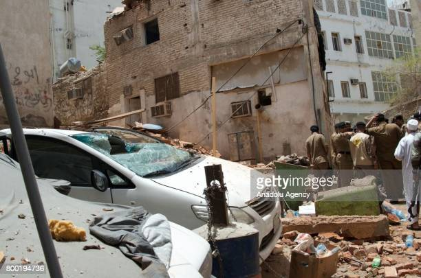 A damaged car is seen as Saudi official inspect a scene of a foiled terrorists attack in Mecca Saudi Arabia 23 June 2017 Security forces in Saudi...