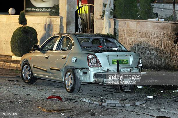 A damaged car is seen in front of the Days Inn hotel in Amman that was targeted by an explosion the authorities said could have been caused by a...
