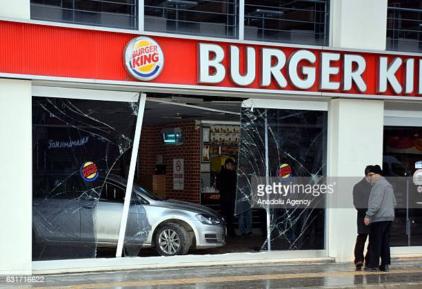 A damaged car is seen inside a fastfood restaurant after a driver confused the gear in Bilecik Turkey on January 15 2017
