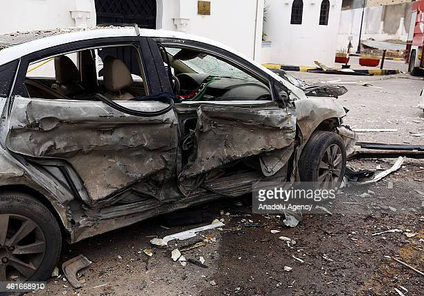 A damaged car is seen near the site of an explosion outside the Algerian Embassy in Tripoli Libya on January 17 2015