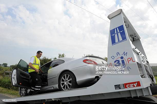 A damaged car is towed by a breakdown mechanic on August 1 2014 in La SuzesurSarthe western France Every year around 15 000 vehicles are repaired on...