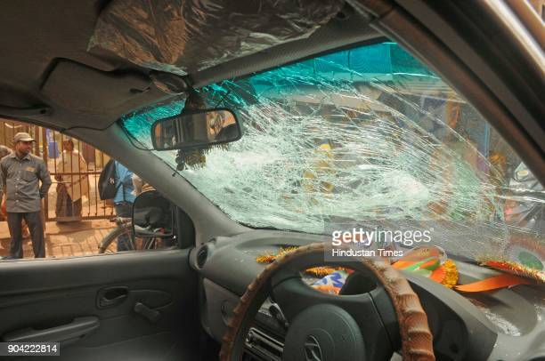 A damaged car of TMC supporters in front of Binani Bhawan due to clash between Bharatiya Janata Party and Trinamool Congress supporters on the issue...