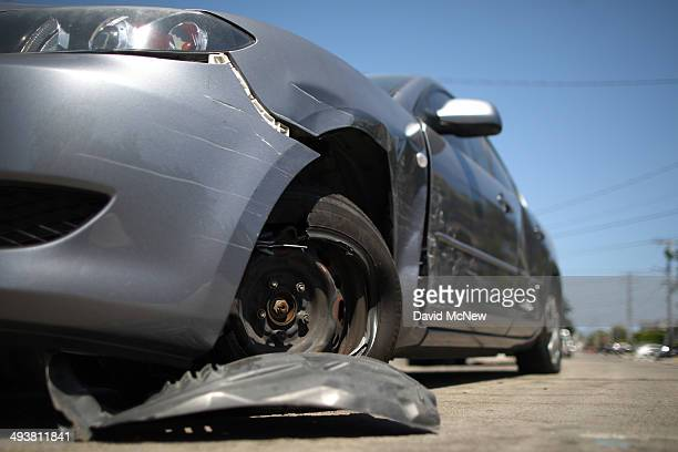 A damaged car remains at a crime scene May 25 2014 in Isla Vista California According to reports 22 year old Elliot Rodger son of assistant director...