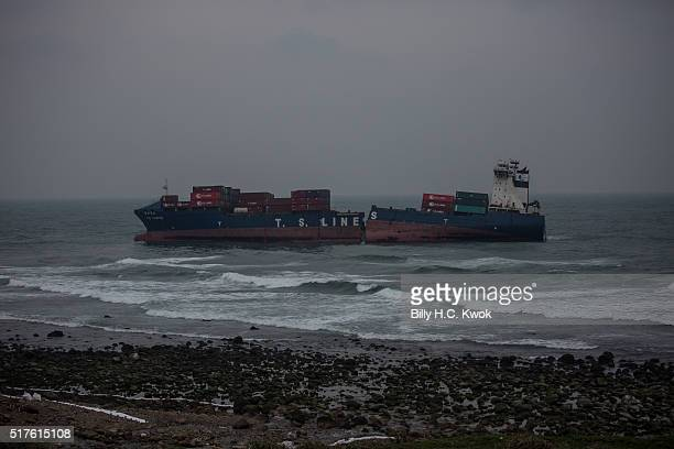 Damaged cargo ship lies near the Taiwan's north coast on March 26, 2016 in Shihmen, Taiwan. An oil slick from a container ship which ran aground off...