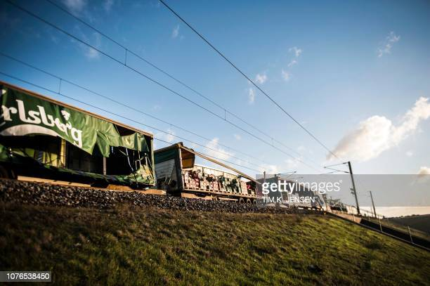 A damaged cargo train is pictured after an accident on January 2 2019 in Nyborg Denmark Several people were killed in a train accident on a bridge...