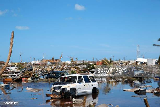Damaged cars and fallen trees are seen after Hurricane Dorian passed through in The Mudd area of Marsh Harbour on September 5, 2019 in Great Abaco...