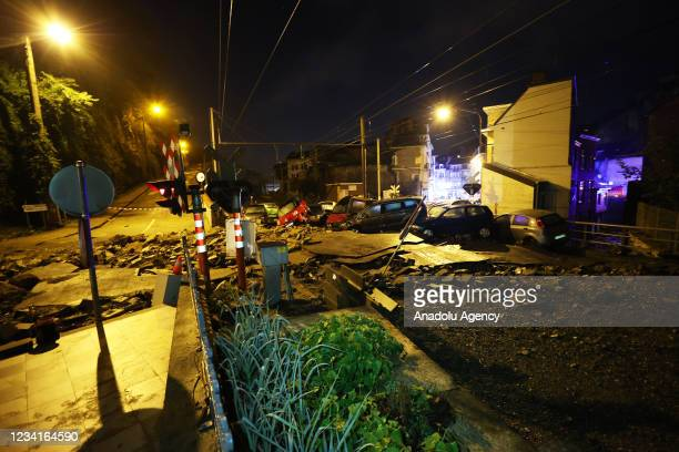Damaged cars are piled up in Belgium's Dinant after heavy rain and floods caused major damage on July 24, 2021.